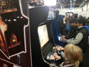 Children playing on the Evo Arcade Machine