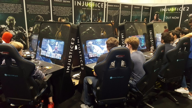 injustice 2 arcade machines at an expo